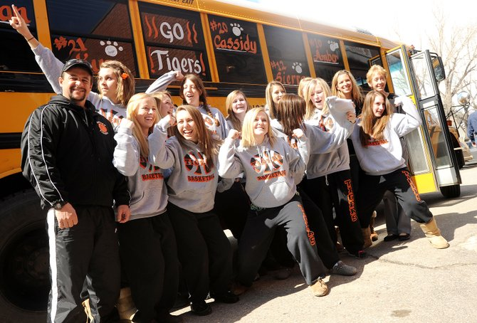 Hayden High School girls basketball players flex their muscles Wednesday afternoon before boarding their bus bound for the Class 2A state basketball tournament in Pueblo. The Tigers play at 5:30 p.m. today against Evangelical Christian Academy in the first round of the eight-team tournament.