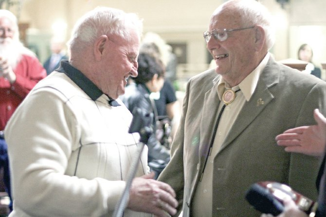 Jim Meineke, left, shakes hands with longtime friend Al Shepherd on Wednesday night during State of the County 2011 at the Holiday Inn of Craig. Shepherd presented Meineke with the Craig Daily Press/KRAI Citizen of the Year Award.