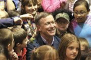Gov. John Hickenlooper gets a surprise offering Wednesday from a child at the Boys &amp; Girls Club of Craig. Hickenlooper fielded a variety of questions from local youths before delivering a keynote speech later that night at the State of the County 2011 event.