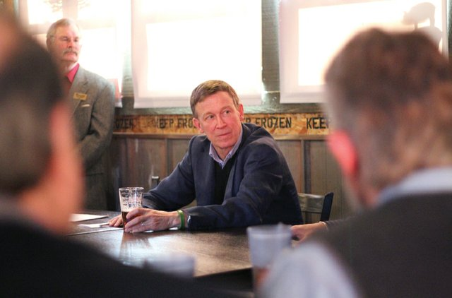 Gov. John Hickenlooper listens to local business owners Wednesday at J.W. Snacks in Craig.