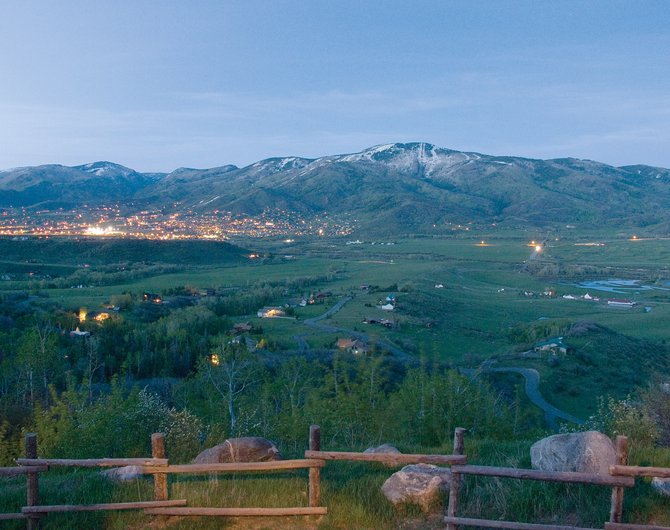 Views from the 9,426-square-foot home on Elk Lane face Haymaker Golf Course and the lights of mountain village.
