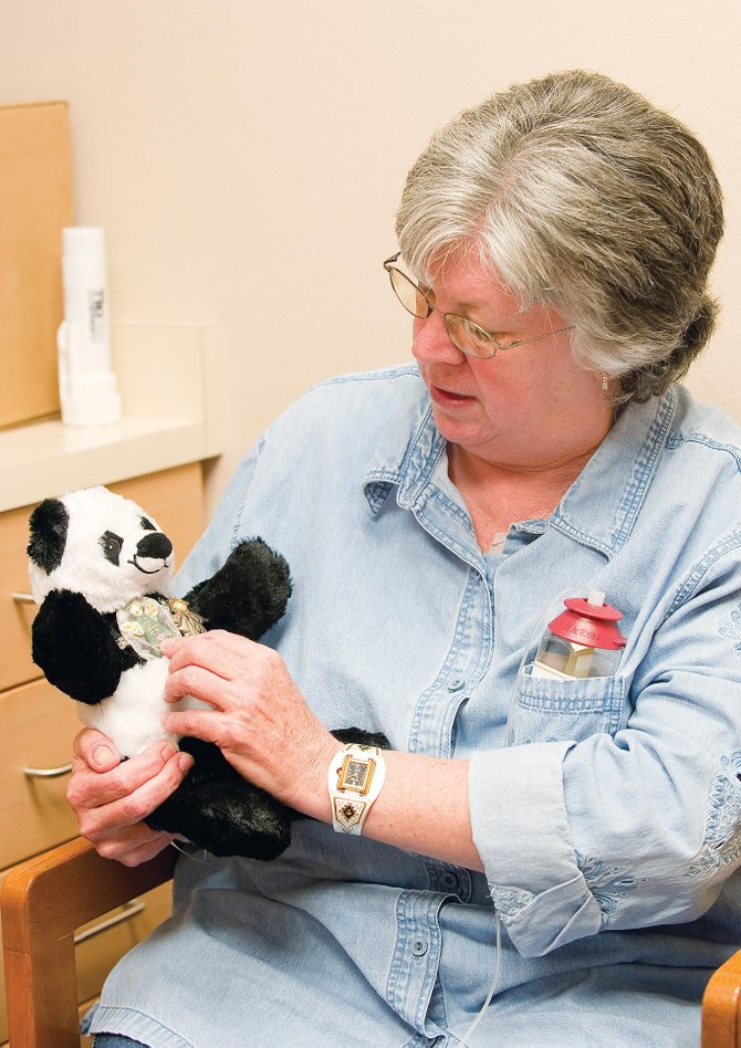 Mary Bea Neu holds her chemo bear while talking about her fight with colon and liver cancer at Yampa Valley Medical Center on Friday. Neu said she regrets putting off getting a colonoscopy but is staying positive. The Build-a-Bear was given to her by her 7-year-old granddaughter and accompanies Neu to every chemotherapy session.