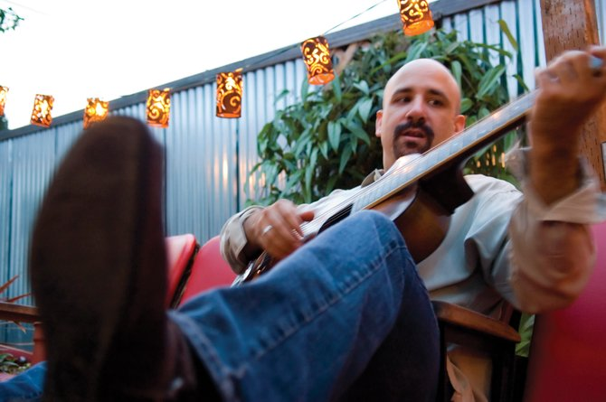 "Tony Furtado, a banjo, slide guitar and vocal artist, plays at 9 p.m. today at Ghost Ranch Saloon to celebrate the release of his new self-produced album ""Golden."""