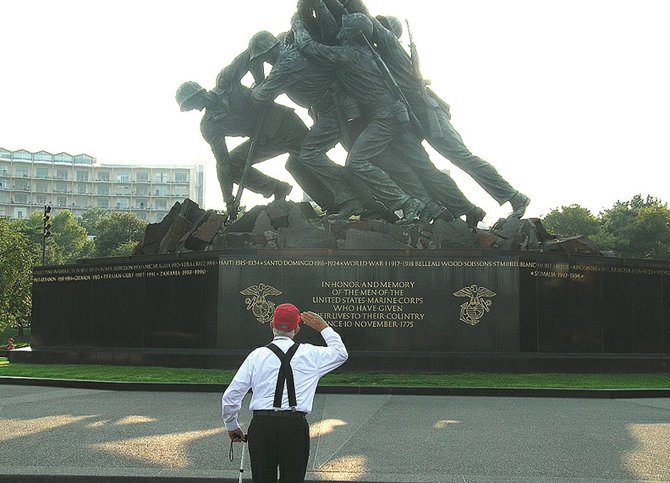 Marine and World War II veteran Joe Booker, then 85, salutes the Marine Corps War Memorial in August 2009. Booker was among the more than 100 veterans to see the nation's capitol and various war memorials as part of the Western Slope Honor Flight Program based in Grand Junction. Booker lives in Frutia.