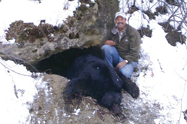 Craig resident Richard Kendall poses with the 703-pound black bear he shot in its cave in late November 2010. Kendall's kill prompted the Colorado Division of Wildlife to draft regulations to prohibit the hunting, taking or harassment of bears in dens. Kendall was also fined by the DOW for using artificial light during his hunt of the bear.