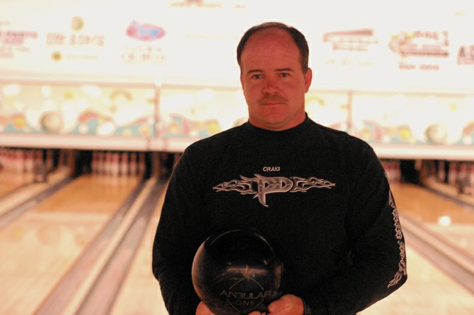 Frank Schmedeke stands in front of lanes three and four Wednesday at Thunder Rolls Bowling Center with his 16-pound ball. Schmedeke bowled a perfect 300 game March 11 on those lanes during his Friday Night Mixed Nuts league.