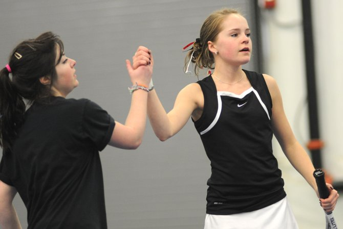 Steamboat's Lauren Siegel, left, and Ali Diehl celebrate a point Friday during their two-set victory against a team from Boulder. The Sailors tennis team won five of seven matches against Boulder.