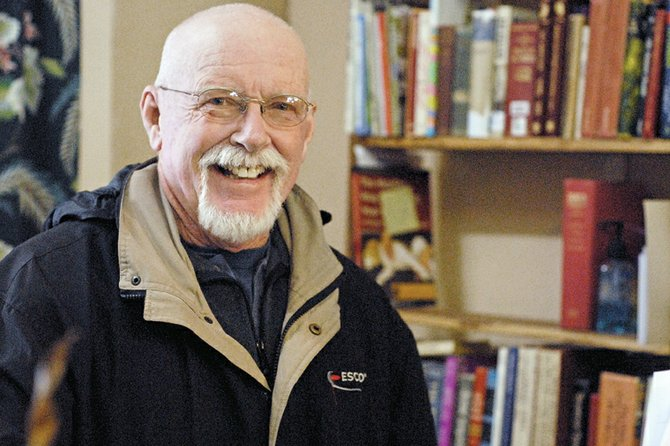 Terry Carwile stands inside Downtown Books, a store he recently purchased. Carwile's late wife, Carol Jacobson, started the store in 2006. Downtown Books has changed hands several times since her death in 2009. Carwile said he purchased the store to preserve his wife's legacy.
