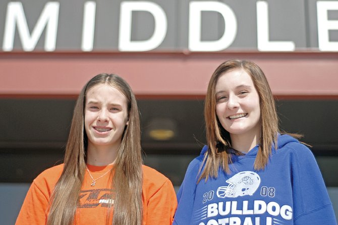 Craig Middle School eighth-graders Laura Secules, left, and Aubrey Campbell were chosen as first-place winners in the Carol Jacobson Memorial Poetry Contest. Secules, Campbell and eight of their classmates will read their winning poems at 6 p.m. Tuesday at Downtown Books, 543 Yampa Ave.