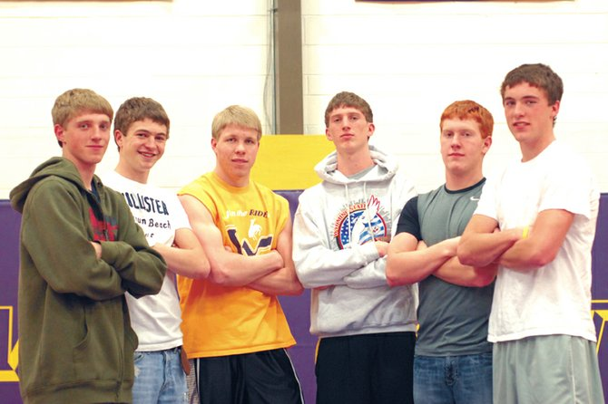 Seven boys competed and won state titles as players on the Little Snake River Valley School's football and basketball teams. Pictured above, from left, are Grayson Lee, Chance Englehart, Sean Rietveld, Miles Englehart, Daniel Wille and Rex Stanley. The seventh player, Conner Lee, was unavailable and is not pictured.
