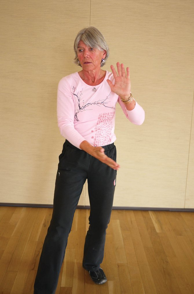 Susan Shoemaker demonstrates a move from Aging Well's new Tai Chi for Osteoporosis class. Movements in the class have been adapted from various tai chi styles to gently improve a person's strength and balance to help prevent falls and fractures.