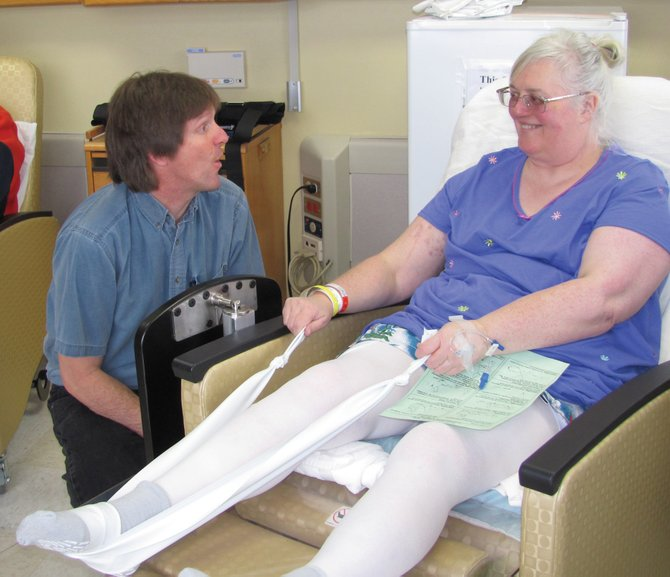 Yampa Valley Medical Center physical therapist Ron Wheeler and Anne Gantt, of Meeker, share a lighter moment during a therapy session.