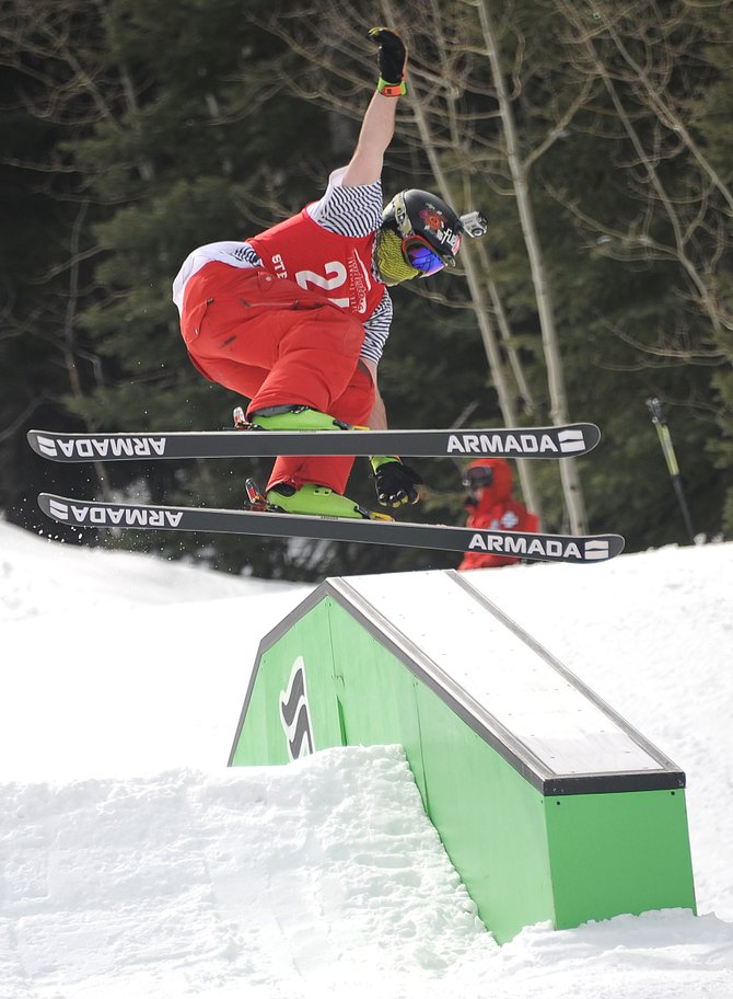 Glenn Little II flies over a rail at the Rabbit Ears Terrain Park at Steamboat Ski Area on Sunday during the slopestyle finale of the Steamboat Park Challenge. Little was second in the men's open ski division.