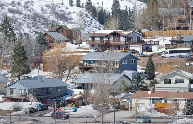 Routt County commissioners discussed an expected drop in property assessments with Routt Country Assessor Gary Peterson during a meeting Monday.