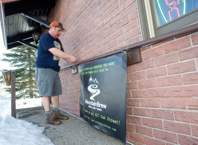 Owner Al Compos posts a moving banner in front of Spill the Beans at it's current location. The coffee shop is moving locations to 427 Oak St. where it will be called MountainBrew.