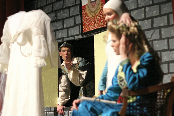 "Robin Hood, played by Skooter Byrnes, left, enters a scene during ""The Somewhat True Tale of Robin Hood,"" which was performed over the weekend at MCHS."