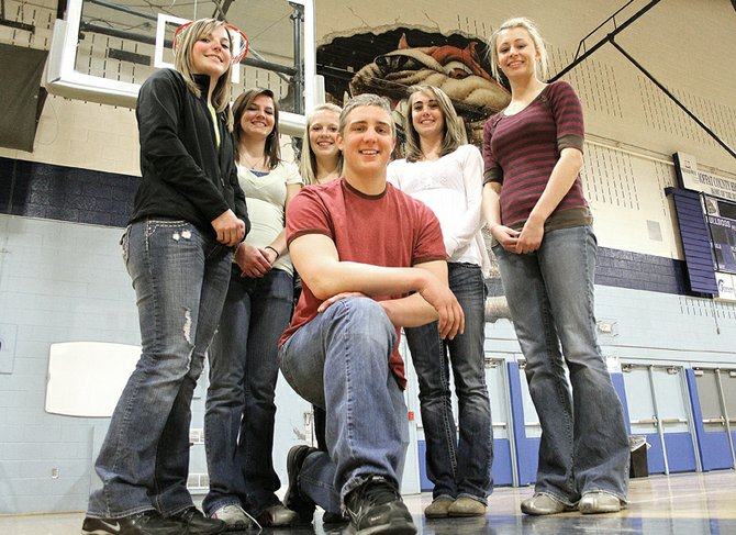 Back row, from left, Annie Sadvar, Melissa Camilletti, Sassy Murray, Maddy Jourgensen and Lauren Roberts pose in the Moffat County High School gymnasium, along with Angelo Raftopoulos up front. Raftopoulos, Camilletti and Roberts earned Western Slope League first-team all-conference basketball honors while Sadvar, Murray and Jourgensen earned honorable mention.
