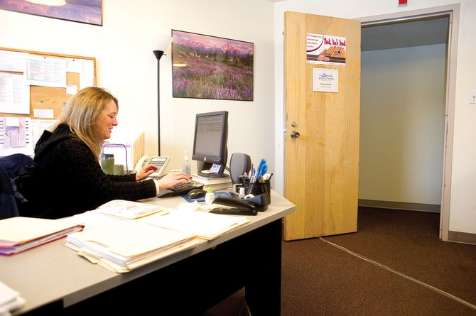 Becky Slamal, program manager for Partners in Routt County, works in her office in Colorado Mountain Colleges Bogue Hall. Partners is one of about 10 tenants still operating in the Bogue Enterprise Center, which is moving to the planned classroom and administration building on the Alpine Campus. Because its moving to a smaller space, many of the existing tenants will have to relocate by summer.