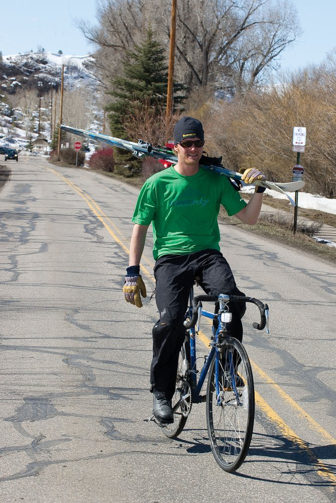 Steamboat Springs resident Pete Kraska rides his bike to work after skiing at Howelsen Hill during his lunch break earlier this week. Improving public trail systems and connections to commercial areas are goals of the Steamboat Springs Area Community Plan, which could be updated in a process that will include public meetings and discussions in April and May.