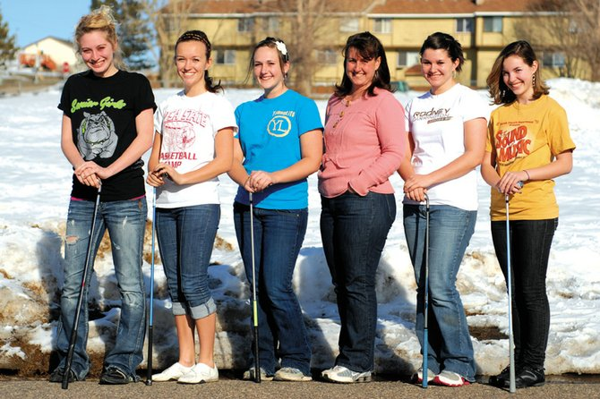 The Moffat County High School girls varsity golf team is, from left, Callie Papoulas, Nike Cleverly, Jessica Matthews, coach Ann Marie Roberts, Samantha Fox and Caitlin Harjes. The Bulldogs won the 4A regional title last season on their home course at Yampa Valley Golf Course and will look to win the school's second title this season.