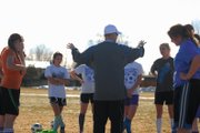 Harry Tripp, middle, the Moffat County High School girls varsity soccer coach, talks to his team March 15 at Woodbury Sports Complex. Tripp is entering his second season as head coach and said he hopes to improve on last year's school record five wins.