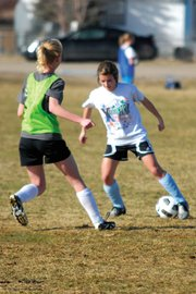 Kelly Ciesco, a Moffat County High School junior, dribbles in front of a defender during a recent soccer team practice. Ciesco was a 2010 all-conference honorable mention last season for the MCHS girls.