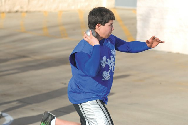 Zach Beauchamp, a Moffat County High School sophomore, practices throwing the shot put March 15 outside of MCHS. The MCHS boys varsity track team earned a share of the Western Slope League title last season and coach Lance Scranton said the team will have the same lofty goals this year.