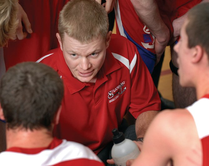 Steamboat Springs boys basketball head coach Luke DeWolfe talks with his team in 2009 at Longmont High School. DeWolfe was named Coach of the Year.