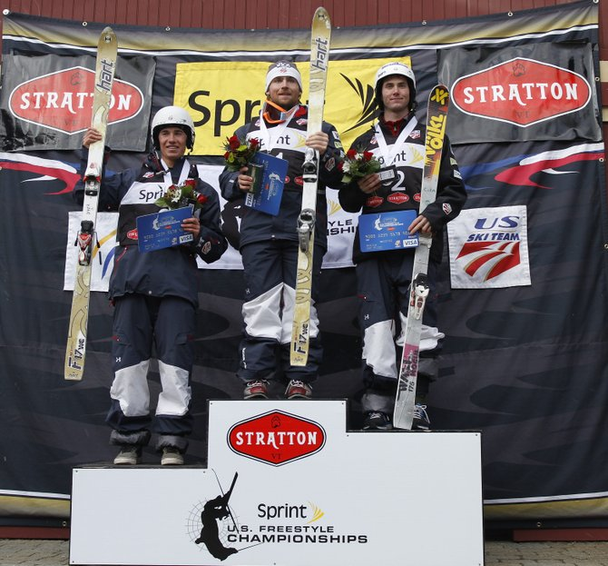 Steamboat Springs moguls skiers Ryan Dyer, from left, Patrick Deneen and Jeremy Cota celebrate after sweeping the podium Friday at the U.S. Freestyle Championships in Stratton, Vt. Deneen won, with Cota in second and Dyer in third.