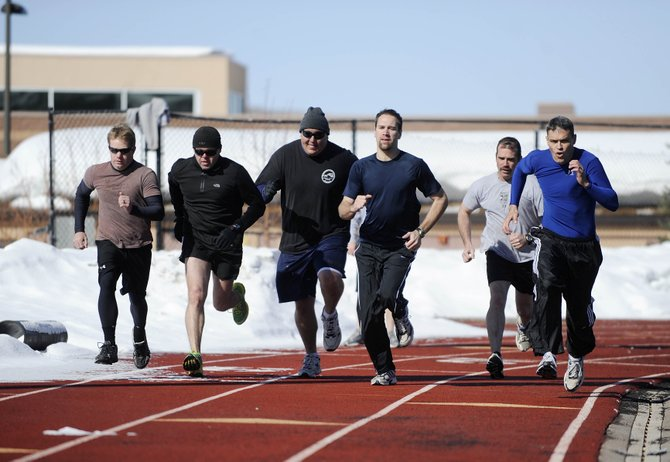 Steamboat Springs Police Department officers and Routt County Sheriff's Office deputies, from left, JD Paul, Seth Merrick, Jake Carlson, Evan Noble, Kurtis Luster, and Sam Silva start their timed 300-yard run at the high school track while trying out for a new inter-agency tactical team.