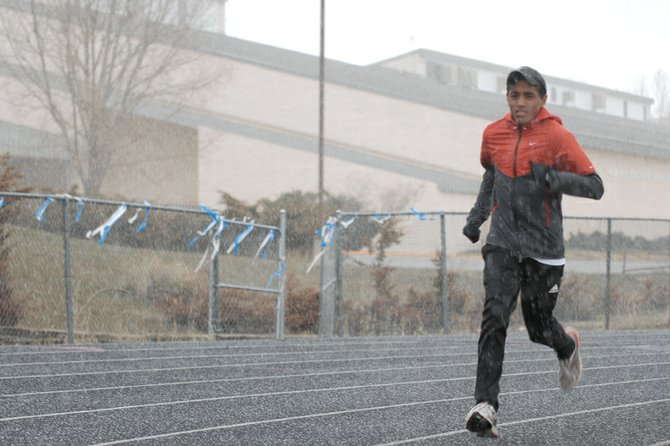Alfredo Lebron, a Moffat County High School junior, practices Monday on the MCHS track. Lebron took first in the 3,200-meter run with a time of 9 minutes, 53 seconds at the Mickey Dunn Invitational on Saturday in Grand Junction.