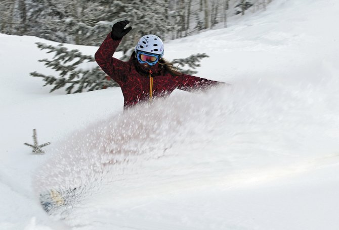 2006 Olympian and repeat X Games medalist Erin Simmons sprays some snow Monday on Ted's Ridge at Steamboat Ski Area. Weekend snowfall on Mount Werner pushed the ski area's snow total past 400 inches for the season, for the third time in the past four winters and the eighth time since 1980.
