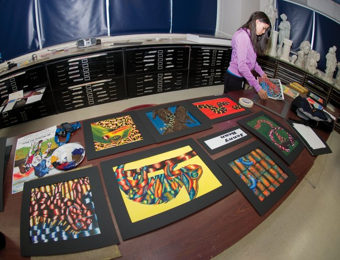 Steamboat Springs High School junior Jenny Bean lays out her artwork for an upcoming student show at the Steamboat Springs Center for Visual Arts. The show will open Friday and is the culmination of the Artist Mentoring Program.