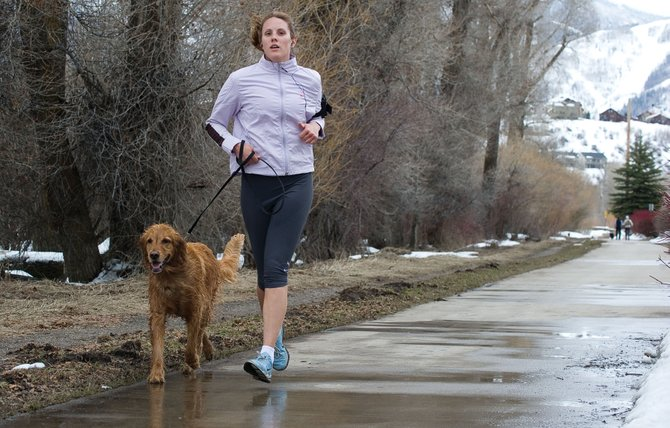 Anya Gunn and her dog Red braved Thursday's mixed weather to run along the Yampa River Core Trail. Steamboat residents should expect a variety of weather conditions this weekend, typical of spring in Colorado.
