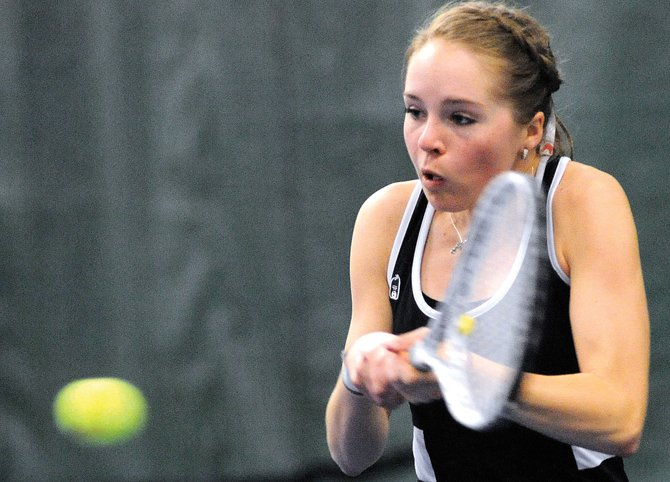 Ali Diehl swings for a return Saturday as the Steamboat Springs High School girls tennis team dualed Poudre Valley. The Sailors won five of the day's seven matches. Diehl's No. 1 doubles team helped, winning in two sets.