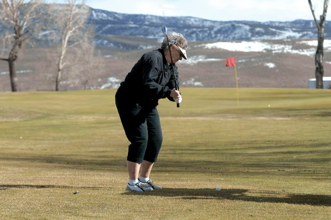 Doreen McIntyre, 67, of Craig, chips toward the green Saturday at Yampa Valley Golf Course. The course opened for the first time this year Saturday, hosting about 115 players.