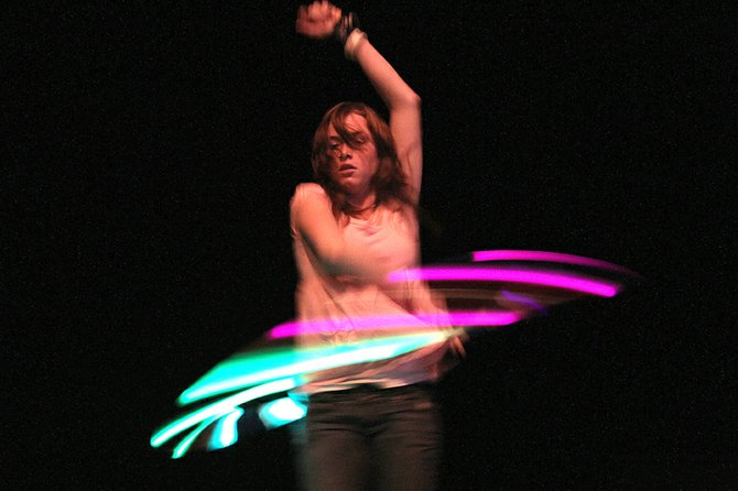 "Craig resident Satori Weis, 16, performs with a lighted hula hoop Saturday during auditions for the Craig Concert Association's annual Talent Show in the Moffat County High School auditorium. Weis said she has been hula-hooping since she was a young girl and hopes to perform at concerts in Denver. ""It is like meditation to me, almost,"" she said of her hobby."
