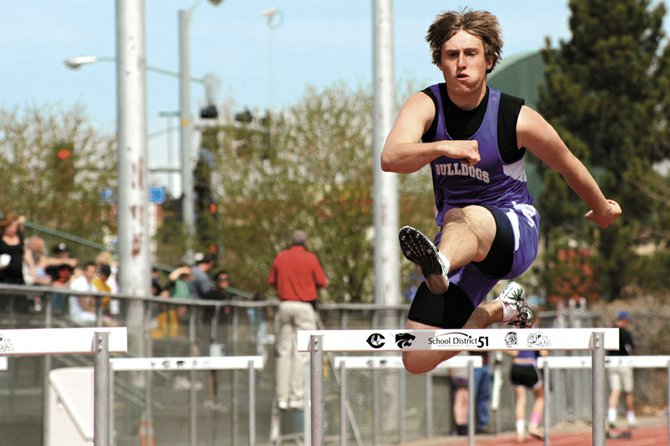 Ryder Seely, a Moffat County High School sophomore, runs the hurdles Saturday at the Warrior Wild West Invitational in Grand Junction. Seeley took third place in the 110-meter hurdles and helped lead the MCHS boys varsity track and field team to a third-place finish.