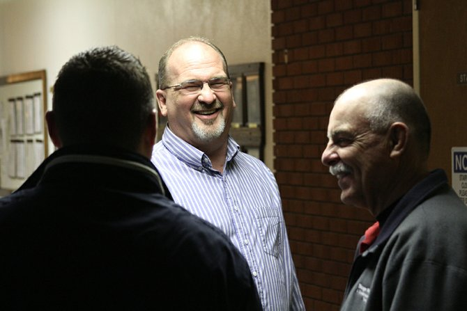 Joe Bird, center, shares a laugh with Ray Beck, right, and Tony Bohrer Tuesday night at the Moffat County Courthouse. All three were vying for a Craig City Council seat. Beck and Bird were successful, with about 20 and 18 percent of the vote, respectively, while Bohrer's 11.9 percent was not enough to secure a council seat. Stephen Hinkemeyer also fell short, with 10.8 percent of the vote. Don Jones will return to the council with 21 percent of the vote. Byron Willems, an incumbent, earned 17.6 percent of the vote and will fill the vacancy left by mayor-elect Terry Carwile.