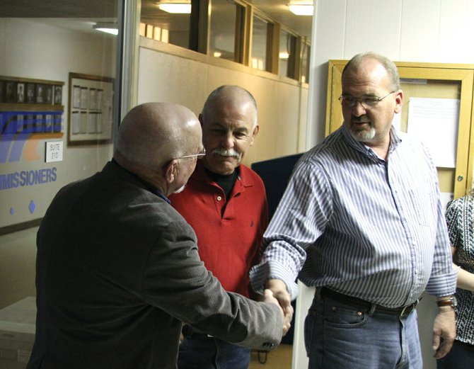 Joe Bird, right, and Terry Carwile, left, congratulate each other as Ray Beck, center, looks on Tuesday night at the Moffat County Courthouse. Bird and Beck were elected to the Craig City Council and Carwile was elected Craig mayor in Tuesday's municipal election. The election included 51.9 percent participation from the city's 3,152 active voters.