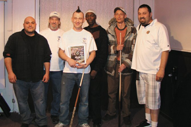 The Motley Cue billiards team, from left, Manny Madrid, John Bishop, Brian Garcia, Thomas Johnson, Jean Haskins and James Barrett, pose March 26 in the Popular Bar after winning the Craig Billiards Congress of America City Championships. The victory guaranteed the team a trip to the 34th Annual BCA National Tournament on May 18 in Las Vegas.