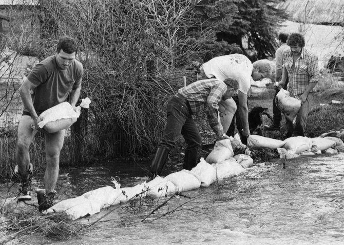 Volunteers sandbagged Butcherknife Creek in Old Town Steamboat Springs on May 17, 1984, after a landslide blocked the stream channel during peak snowmelt.