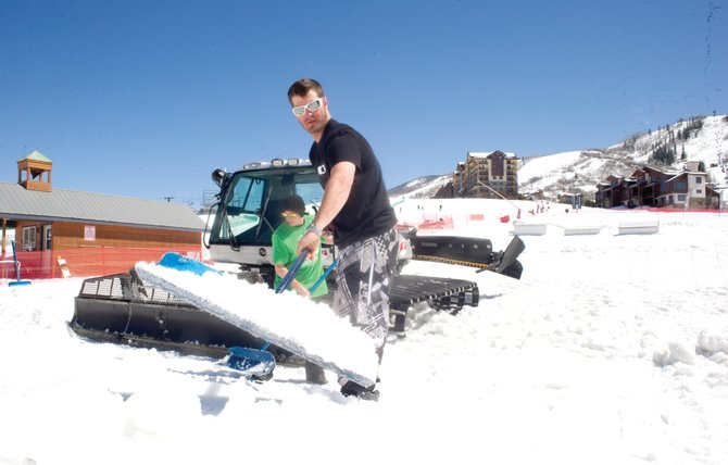 Nick Roma, front, who runs terrain parks for Steamboat Ski Area, and Brandon Harrison set up a ramp for the Red Bull Buttercup. The Buttercup, a snowboarding competition for all levels, will take place all day Friday at the base of the mountain. Practice will begin at noon, with the qualifying runs slated to start at 1 p.m.