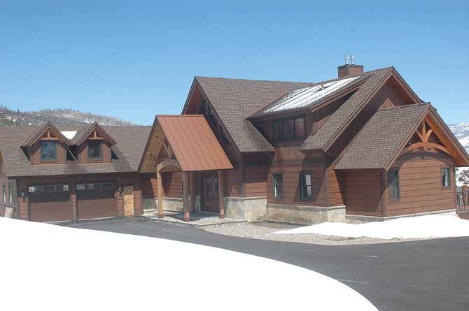 The Country Green subdivision is 12 minutes and one traffic light away from Steamboat Ski Area, most of the distance on a lightly traveled county road. The price of the new home recently was dropped to $2 million.