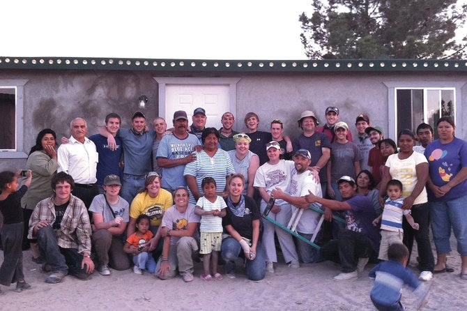 Craig native Morgan Cobb, standing center with the bandana and sunglasses, poses with the rest of the group that built a home in three days for the Caldez family in Juarez, Mexico. Victor and Lourdes Caldez, left, of Cobb, and family had been waiting for three years to receive the home from Casas por Cristo.