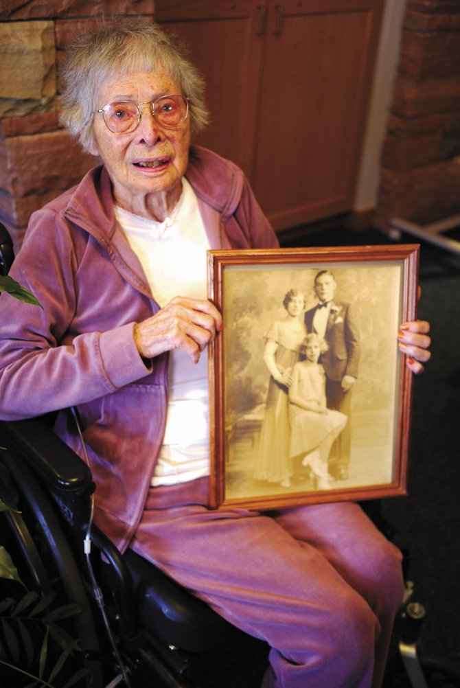 Anna Wichern, who will be 100 years old in June, holds a photo of herself and her siblings as young adults. Wichern is among Colorado centenarians and soon-to-be centenarians who will be honored at a Steamboat Springs celebration in May.