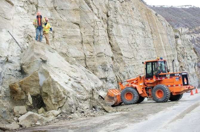 Colorado Department of Transportation employees use a blasting cap to break up a large rock after a rockslide in Mount Harris Canyon on March 28.