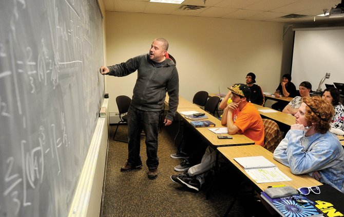 Alex Krolik, assistant professor of developmental mathematics, teaches a class Tuesday at Colorado Mountain College's Alpine Campus. The college approved tuition rates for the 4-year programs Colorado Mountain College expects to offer in fall.