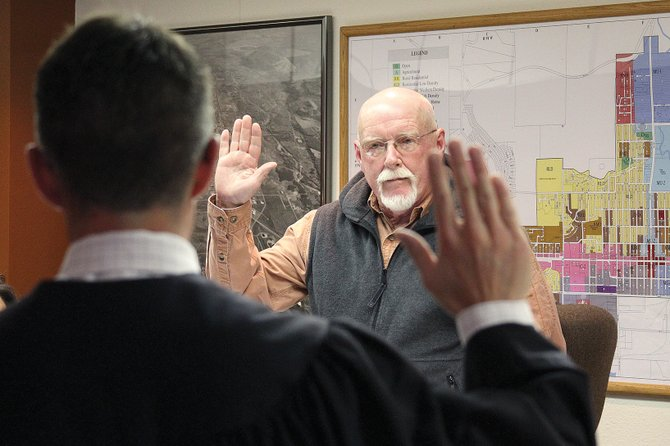 Craig mayor Terry Carwile is sworn into office by municipal court judge Kevin Peck during Tuesday's regular city council meeting. Former Mayor Don Jones, who is term limited, said it would be tough to surrender the reins to Carwile, but said he had faith in the new mayor. Peck also swore in Jones, Ray Beck, Byron Willems and Joe Bird onto the city council Tuesday.