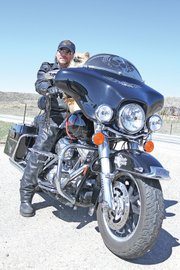 Murray Fenstermacher poses on his Harley Davidson with Alvin on U.S. Highway 40 east of Craig.